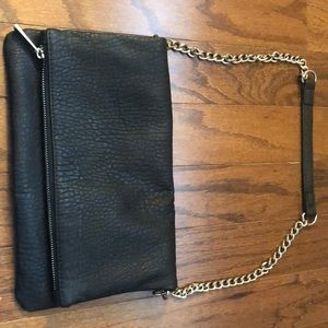 Black clutch with silver chain handle